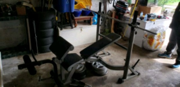 Heavy duty bench press with 290lbs of weights  1fd0bbcd-4b09-4888-81ba-b64c17c34df8