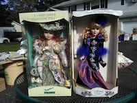 two porcelain dolls with brown boxes