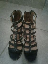 pair of black leather gladiator sandals Montréal, H1R 2W1