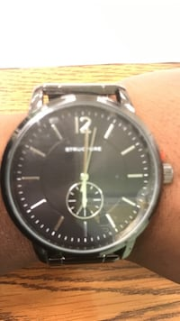 round gray chronograph watch with black leather strap