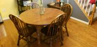 round brown wooden table with four chairs dining set Frederick, 21703