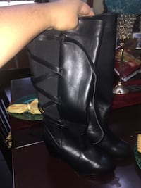 Women's black leather wedge boots