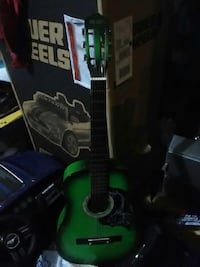 green and black Valley brand classical guitar Apopka