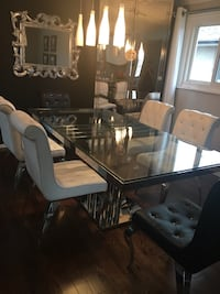 Glass and Crome table with six chairs dining set  547 km