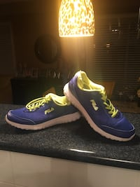 pair of blue-and-yellow Fila running shoes8.5