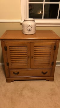 Brown wooden end table with cabinet