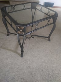 Contemporary glass and steel end table.
