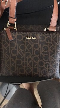 brown and black monogrammed Coach leather handbag Dumfries, 22025