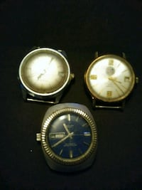 three round gold-colored analog watches with bands 1202 mi