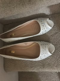 pair of white leather flats Calgary, T2A
