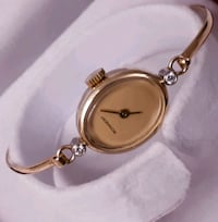 9ct gold with two small diamonds ladies watch