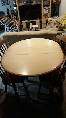 oval grey and brown wooden dining set
