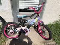 toddler's pink and white bicycle Palm Harbor, 34683
