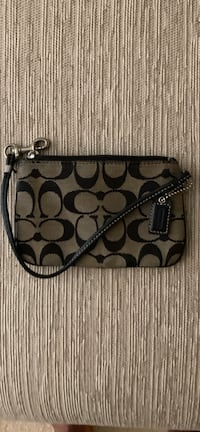 brown and black Coach monogram wristlet Alexandria, 22306