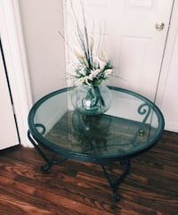 round clear glass top table with gray metal base Kissimmee, 34741