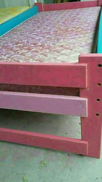 pink and blue wooden bed frame