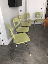Five green and gray metal chairs 791 km