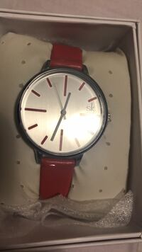 round silver analog watch with red leather strap Los Angeles, 91401