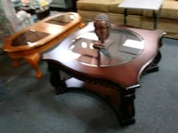 Large dark wood and glass coffee table Houston, 77077