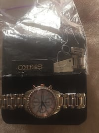 silver round chronograph watch with link straps Toronto, M4N 1X8