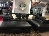 Modern sectional with adjustable headrest. Brand new. Colors: Black and Red.  Cedar Hill