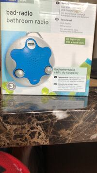 two blue and white fidget spinners in boxes Brampton, L7A 2B1