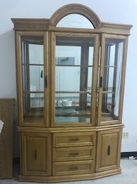 """Dining room set includes glass cabinet with glass shelving and dimensions of 86""""x55"""" along with an oak table containing 6 chairs with the table extension piece. The dimensions of the table are 66""""x41"""" and the extension piece is 41""""x20"""". Chicago, 60646"""