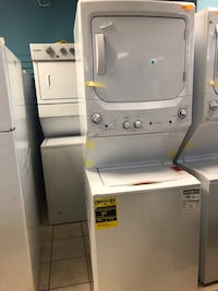 """Brand New 27"""" GE Gas Stacked Laundry Center (Scratch and Dent)"""