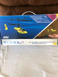 white and blue helicopter toy box