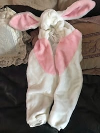 baby's white and pink footie pajama