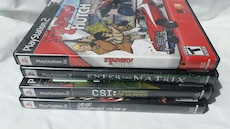 four PS2 game cases