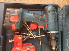 Black and green bosch cordless hand drill