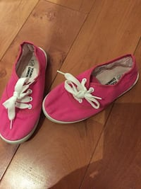 pair of pink lace-up low-top sneakers
