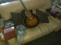 Wood& leather couch, guitar and everything seen Marysville, 95901
