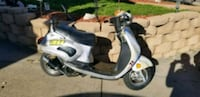 white and black motor scooter Lakewood, 80401