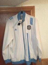 white and blue zip-up jacket 530 km
