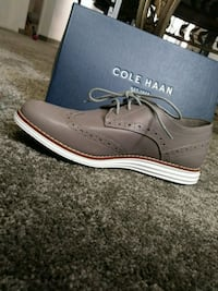 unpaired gray Cole Haan leather wingtip oxford sho