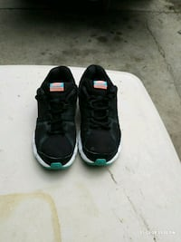 pair of black Initiator Nike Running shoes Lincoln, 68522