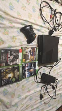 Black xbox 360 console with controller and game cases Milwaukee, 53216