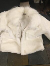 White and brown fur coat