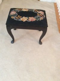 Black floral needlepoint bench.