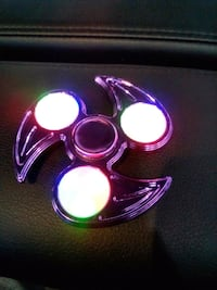 purple 3-blade fidget spinner with LED
