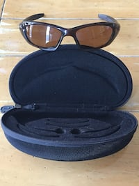 Oakley Sunglasses with bronze lens tint, come with case