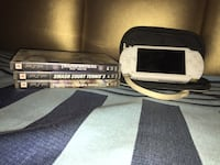 white Sony PSP portable console with three game cases collection New Delhi, 110030