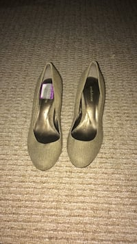 pair of gray suede heeled shoes