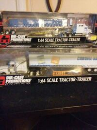 two white scale tractor trailers