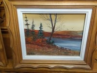 lake painting with brown wooden frame