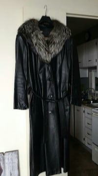 Woman's leather coat with fur trim.
