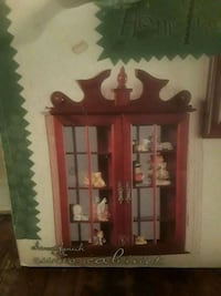 BRAND NEW IN BOX CURIO CABINET ..NEED TO SALE ASAP Houston, 77033