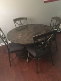 Round gray marble table with chairs  Bossier City, 71111